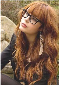 Wavy red hair with straight bangs