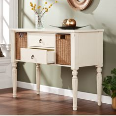 The Upton Home Catalina console with storage baskets provides a quaint country design and plenty of room for storage. Two pull out drawers and two wicker storage baskets combine with a beautiful antique white finish for a great addition to any home.