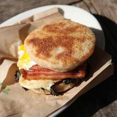 Here, F&W editors name their favorite breakfast sandwiches across the country, from biscuit bombs to a version that uses sliced bread pudding in place of bread.