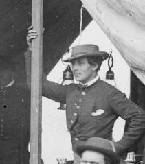 Kate Warne, a Union spy during the Civil War - maybe.  Cropped from a larger photo of Allan Pinkerton and his operatives during the War. This is the only person in that photo without facial hair, and the figure also appears feminine.