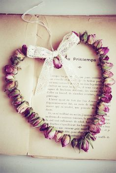 LOVE this heart wreath made from rosebuds!