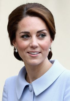 Tuesday, 11 October 2016 ---- Kate Marks Royal Milestone with First Overseas Solo Trip to the Netherlands. The Duchess wore her hair in a chic updo and completed the look with new pearl earrings. It turns out they are in fact the Queen's pearl and diamond earrings and have been loaned to Kate.