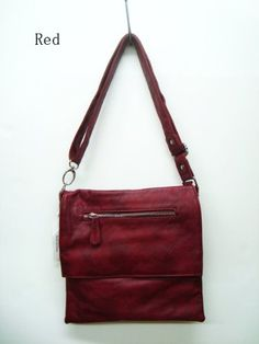 This designer inspired handbag is the perfect complement to your classic look. This crossbody-style bag is made of synthetic leather. Top flap closure. Small bag. Top zip closure. Large compartment. Outside zip pocket. Spacious divided interior with zip and open pockets. Adjustable shoulder strap. We are a New York based wholesale bag company. We are offering the best price for quality products. This sophisticated style of handbag is made of grea...