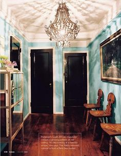 Pale blue walls and a glossy black door sure are tempting! #TheWellDressedRoom