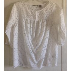 Liz Claiborne Eyelet Blouse Excellent condition. Super cute Liz Claiborne eyelet top. Kind of a peasant style with a keyhole front. Hook and loop closure at top. Geometric pattern of triangle eyelets. 3/4 length sleeves. Size medium. Liz Claiborne Tops Blouses