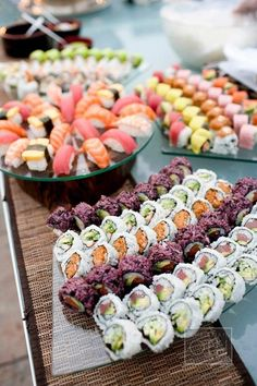 Wow your guests with a delicious spread of assorted freshly made sushi during cocktail hour | Brides.com