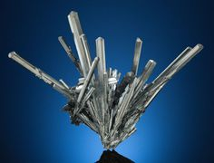 "This stibnite ""swords"" are made of the elements antimony and sulfur and are up for auction on June 2, 2013 with an opening bid of $32,500. This frozen firework of a mineral was found in the Lushi Mine in Henan, China and measures 9 by 10 by 4 inches (23 by 25 by 10 cm)."