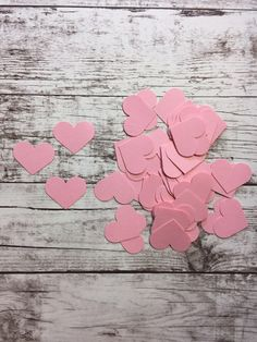 50 Light pink heart hand punched diecuts. Each heart measures roughly 1W. These are great for themed parties, scrapbook pages, embellishments on