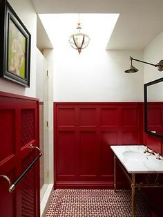 Bathroom with red wainscoting, white walls, black accents, red & white tile floor.