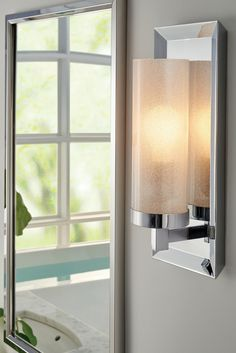 Pippin 1 - Light Wall Sconce by Feiss: The beautiful sparkle from the White Sugar glass shade of the transitional Pippin one-light wall sconce from Feiss ensures this streamlined silhouette makes a bold design statement. In a Chrome finish for a more modern look. Complements modern bathroom decor.