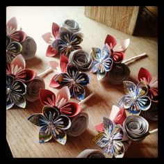 www.flairforfleur.co.uk affordable paper floral arrangements. Corals and peaches with hints of silver and sparkle mixed with Marvel Comic paper origami flowers and rolled roses. Perfect for corsages!