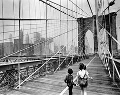 "May 15, 1979: From Brooklyn Heights, a pair of venturesome children traversed the newly-painted Brooklyn Bridge into Manhattan as ""sunshine was just triumphing over hazy fog."" Photo: Neal Boenzi/The New York Times"