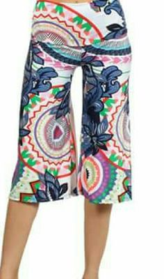Gorgeous Colorful Floral Printed Cropped Capris Brand new!! Beautifully Colored just for summer!! Floral Printed Cropped Capris can make any day this summer just POP!! Add a top that's  pink, green, white, yellow, or even orange, or all the colors, and you'll turn heads this season!!!! Pants Capris