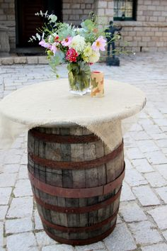 Guest tables near the bourbon bar! Totally appropriate to use whiskey barrels in this case. Love the contrast of soft, feminine floral arrangements in a bourbon bar area, too. <3
