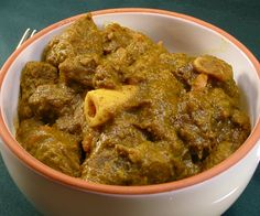 This is absolutely mind-blowingly good. Goat basically tastes like lamb, but is far leaner. (Lamb is the fattiest of the red meats.) It's very popular in a variety of ethnic cuisines, but for some reason has yet to gain a real following in the US. This recipe is inspired by the curried goat roti from Penny's Caribbean Cafe. While Penny doesn't share her secrets, this tastes awfully similar. Go get yourself some goat (or lamb if you must) and try it out!