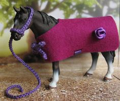 I not only repaint schleich horses, sometimes I make (very simple) blankets and halters for them :-)
