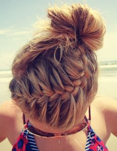 Side french braid on top with messy top knot.