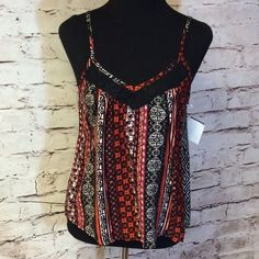 PRETTY TRIBAL PRINT TANK STYLE BLOUSE Very cute rayon blouse with lace detail on the front and back. Adjustable straps. Super cute.  JUNIOR SIZING Tops Blouses