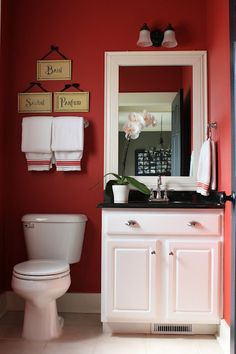 small traditional bathroom with dark red walls and white accents... Red Bathroom Inspiration from Bathroom Bliss by Rotator Rod