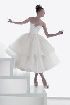 bride wearing a double layered ballerina tea length wedding dress @myweddingdotcom