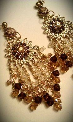 High-End Swarovski Crystal Chandeliers in Smoked Topaz, Light Colorado Topaz, & Caramel shades... Stunning for fall!!