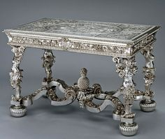 1699 English Table in the Royal Collection, UK. On his accession in 1760, George III inherited three late seventeenth-century suites of silver tables, mirrors and stands. These were the remnants of far larger suites of silver furnishings, which had been displayed throughout the royal palaces during the reigns of the later Stuarts. The popularity of silver furnishings had however diminished in the first half of the eighteenth century.