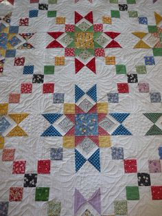 scrappy quilts, stars and irish chains.