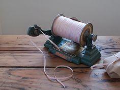 Vintage cast iron thread dispenser