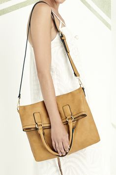 Camel tote with a fold-over front and crossbody strap that transforms it into a messenger bag
