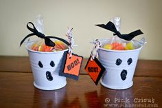 Simple thumbprints make a fun ghost face for a treat pail.