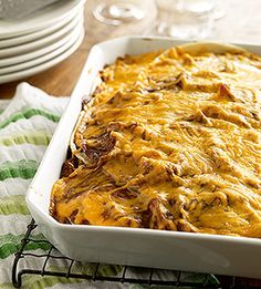 mexican casserole. chicken, refried beans, tortillas, sour cream, and cheese.
