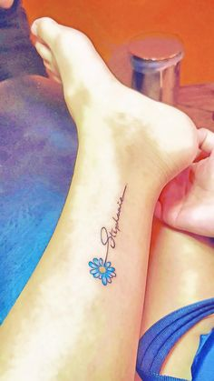 Small flower tattoos with name on ankle