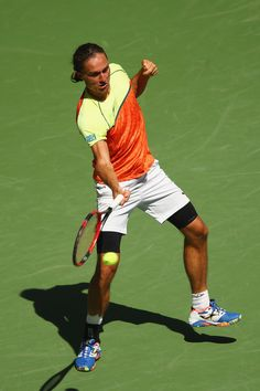 Alexandr Dolgopolov of Ukraine returns a shot against Rafael Nadal of Spain during their fourth round Men's Singles match on Day Eight of the 2017 US Open at the USTA Billie Jean King National Tennis Center on September 4, 2017 in the Flushing neighborhood of the Queens borough of New York City.