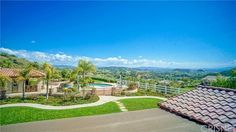 Spacious grass areas surround the home, elevated pool and spa with fire pit and unobstructed views, plus olive tree grove and award winning vineyard make this a completely uniqu