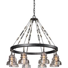 Bring industrial appeal to your dining room or den with this handcrafted wrought iron chandelier, showcasing an old silver finish and clear glass shades.