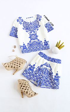 Blue White Short Sleeve Floral Crop Top With Shorts Suit Type : Shorts Pattern Type : Print Color : Blue Material : Polyester Neckline : Strap Sleeve Length : Short Sleeve Style : Street Size Available : S,M,L,XL