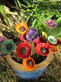 I want these garden decorations by Ceramic Poppy (France)...looks like I have flowers all the time!