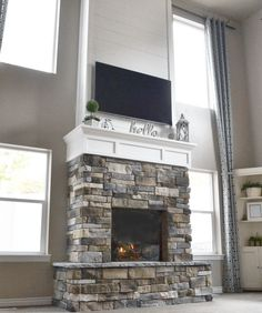 DIY Fireplace with Stone & Shiplap - Nik Nak Shack : Check out our DIY fireplace! We went from a non-existing fireplace, to a beautiful two story fireplace, with a hearth & mantel, using shiplap and stone. Two Story Fireplace, Fireplace Facing, Corner Gas Fireplace, Build A Fireplace, Tall Fireplace, Shiplap Fireplace, Home Fireplace, Fireplace Remodel, Fireplace Design