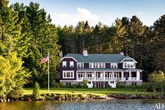 On the picturesque shores of Lake Placid, architect Gil Schafer crafts a family house inspired by the character and charm of classic Adirondack retreats.