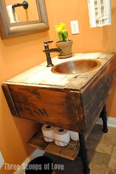 a reclaimed cabinet becomes a sink vanity - this is so cool! By Three Scoops of Love