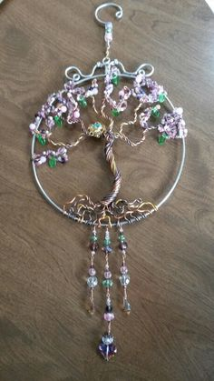 Wire wrapped beaded Tree of life sun catcher with bird's nest.