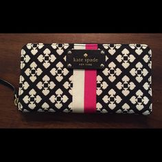 Kate Spade Wallet BRAND NEW! Never used!! Gorgeous Kate Spade wallet- cream and black, with a white/cream and pink stripe. Zip closure with pocket on back of wallet. Multiple card slots on both sides, and zipper pouch in the middle. Only selling bc I have another KS wallet that I am very attached to! Love, love, love this wallet! Retired print- price somewhat firm, but please make an offer and I will consider it! kate spade Accessories