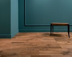 Teal walls with wooden floors