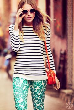 Print mixing at its finest - Striped top + teal flocked pants. Tres chic!