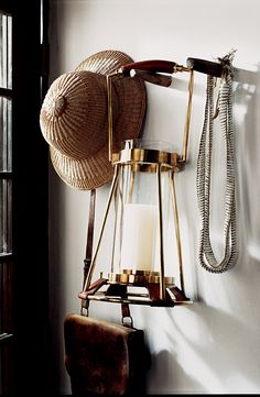 Made with saddle leather and brass, Ralph Lauren Home's Spencer Hurricane is the perfect lighting accessory for the home or a safari trek