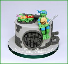 https://flic.kr/p/nrCbY6 | Teenage Mutant Ninja Turtles Birthday Cake | A TMNT birthday cake for Lewis' 5th Birthday. Sugar turtle heads and Leonardo sitting on the edge of the cake. Inspired by a cake from Mira Que Tarta.