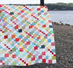 Scrappy Summer - Cluck Cluck Sew. Love the 4-patch accents. This quilt is a blast to look at. LOVE it! It's the perfect way for stretching charm packs or for using leftovers. I have a horrible habit of buying 1 charm pack and then it's not enough to make anything out of except bags. LOL. LOVE this 4-patch thing. Ok, I know I already said that, but I'm blown away how something so simple has such a hugh impact.