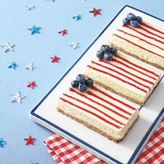 Decorate these easy cheesecake bars as American flags by using blueberries for the star section and piping jelly in thin lines to resemble the strips. It's a great make-ahead dessert for summer entertaining.