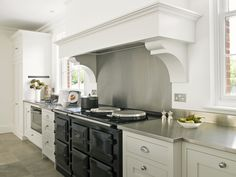 Felsted Kitchen with 5 oven black Aga and chimney breast extractor. Kitchen Interior, Beautiful Kitchen Cabinets, Bespoke Kitchens, Aga Kitchen, Slate Kitchen, Kitchen Layout, Kitchen Chimney, Kitchen Renovation, Luxury Kitchen Design