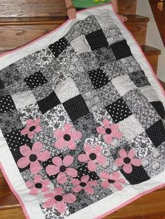 Black and White Quilt with Pink Flowers .... .... .... http://www.craftsy.com/blog/2014/03/black-and-white-quilting/